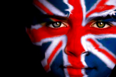 Portrait of a young boy with the Union Flag ( Union Jack ) of Great Britain on his face.